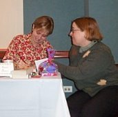 Laura signs a book for Jennifer Stevenson at the Chicago area 2003 All For Love event, which raised over $2100 for the American Heart Association.