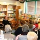 A rapt audience listens to Laura speak at Buttonwood Books.