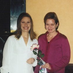 Laura (right) accepts a rose from Chicago-North president Deb Rittle, signifying the sale of Night Swimming to Ivy Books in 2002.